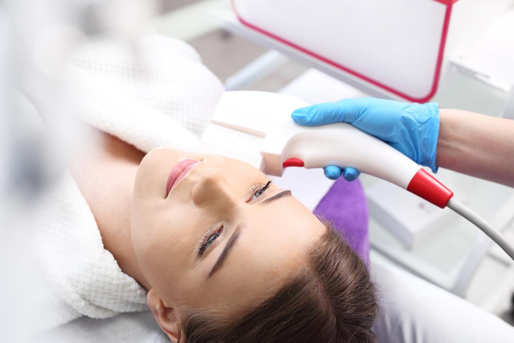 ;patent receiving facial treatment