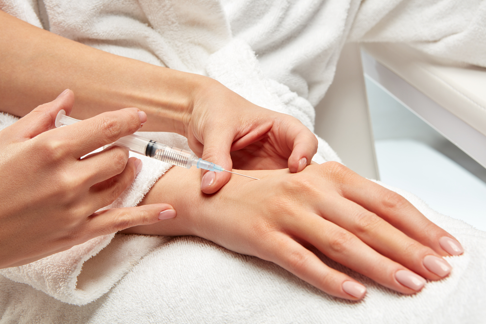 patient's hand being injected