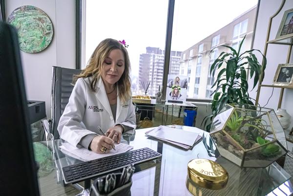 Dr. Tina West at her desk