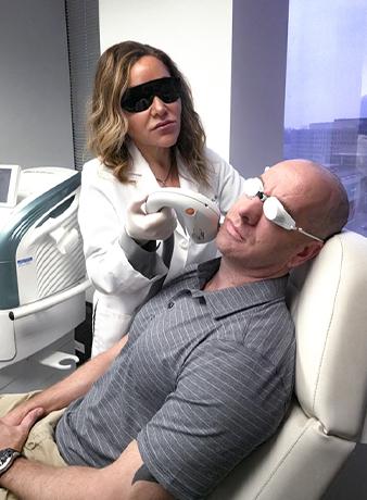 patient receiving facial treatment